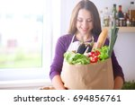 young woman holding grocery... | Shutterstock . vector #694856761