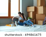 young couple sitting on the... | Shutterstock . vector #694861675