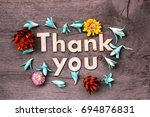 thank you lettering.wood... | Shutterstock . vector #694876831