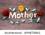 mother lettering.wood letters... | Shutterstock . vector #694876861
