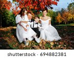 happy family in a city park on... | Shutterstock . vector #694882381