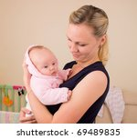 mother with 3 month old baby - stock photo