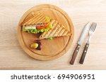 two sandwiches of triangular... | Shutterstock . vector #694906951