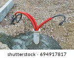 Electric cable in corrugated pipe prepared for installation of street lighting system - stock photo