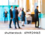 abstract blur group of people... | Shutterstock . vector #694924465