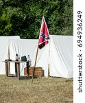 Small photo of Confederate flag in front of an American Civil War re-enactment camp