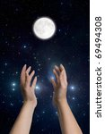 woman hands in gesture of prayer to the moon - stock photo
