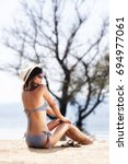 sexy girl with a hat sunbathing ... | Shutterstock . vector #694977061