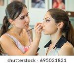 makeup artist makes models eye... | Shutterstock . vector #695021821
