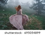 woman from the back in a pink...   Shutterstock . vector #695054899