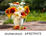bouquet of colored daisies on a ... | Shutterstock . vector #695079475