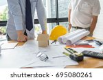 team engineering with tool on... | Shutterstock . vector #695080261