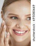 beauty skin peeling. closeup... | Shutterstock . vector #695080669