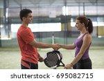 paddle tennis players handshake ... | Shutterstock . vector #695082715