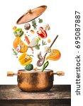 healthy vegetarian eating and... | Shutterstock . vector #695087887