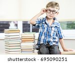 little funny boy is seating...   Shutterstock . vector #695090251