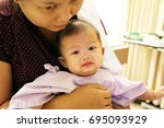 asian boy with mother in... | Shutterstock . vector #695093929