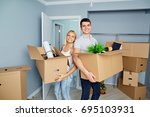 happy couple in a new apartment ... | Shutterstock . vector #695103931