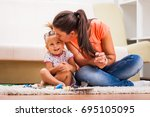mother and daughter in their... | Shutterstock . vector #695105095