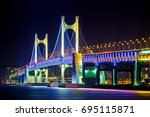 gwangan bridge at night in...   Shutterstock . vector #695115871