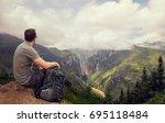 traveler with backpack enjoying ...   Shutterstock . vector #695118484