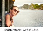 pretty woman traveler sails on... | Shutterstock . vector #695118511