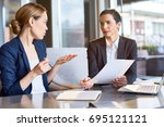 confident financial managers... | Shutterstock . vector #695121121