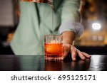 bartender pouring the red... | Shutterstock . vector #695125171