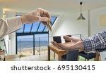 realtor giving house key to... | Shutterstock . vector #695130415