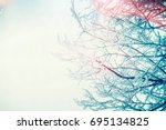 winter snowy tree branches at... | Shutterstock . vector #695134825