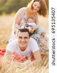 happy family on the walk in the ... | Shutterstock . vector #695135407