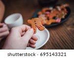 gingerbread cookies in people... | Shutterstock . vector #695143321