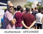 people  queue  in  line up   ... | Shutterstock . vector #695144005