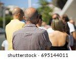 people  queue  in  line up   ...   Shutterstock . vector #695144011
