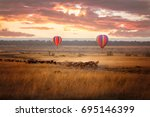 sunrise over the masai mara ... | Shutterstock . vector #695146399