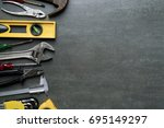 old tools on black background | Shutterstock . vector #695149297