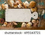 Small photo of Autumn dinner concept - cutting board with copy space - fresh porcini boletus oak muchrooms, high quality,restaurant menu, a la carte