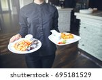 waiters carrying plates with...   Shutterstock . vector #695181529