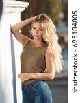 blonde woman in summertime in... | Shutterstock . vector #695184805