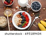 oat flakes in plate with... | Shutterstock . vector #695189434