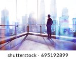 young businessman looking out... | Shutterstock . vector #695192899