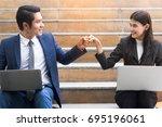 asian colleagues team success... | Shutterstock . vector #695196061