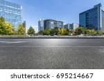 empty road with modern business ... | Shutterstock . vector #695214667