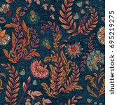 Stock photo blue denim with colorful floral print seamless wallpaper 695219275