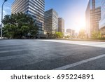 empty road with modern business ... | Shutterstock . vector #695224891