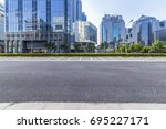 empty road with modern business ... | Shutterstock . vector #695227171