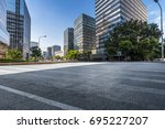 empty road with modern business ... | Shutterstock . vector #695227207