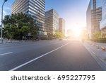 empty urban road and buildings... | Shutterstock . vector #695227795