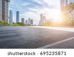 empty road with modern business ... | Shutterstock . vector #695235871