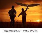 children launch a kite in the... | Shutterstock . vector #695249221